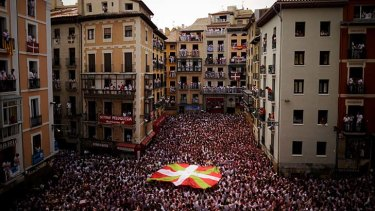 Huge crowds ... participants stand in front of the Town Hall of Pamplona, northern Spain.