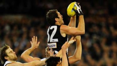 Travis Cloke leaps to take a strong mark.