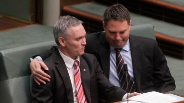 A friend in need: Embattled MP Craig Thomson receives a supportive hug from fellow Labor MP Richard Marles during a procedural vote yesterday.
