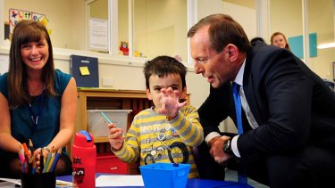Opposition Leader Tony Abbott meets Ethan Ellis, 4, on a visit to the Little Learners Autism Centre in Maidstone.
