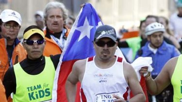 Chilean miner Edison Pena on his way to the finish line of the New York City Marathon on Sunday.