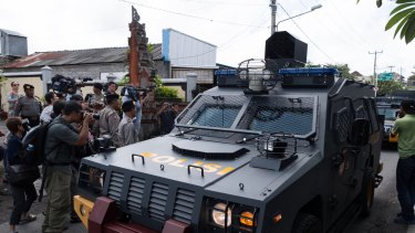 Armed police vehicles complete a practice run to the parole offices in Denpasar, where Corby will have to sign papers before being deported.