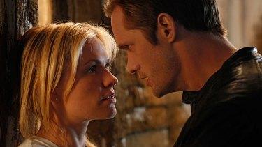 Alexander Skarsgard and True Blood co-star Anna Paquin on set.