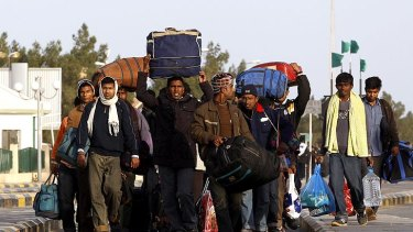 Foreign workers fleeing the fighting in Libya.
