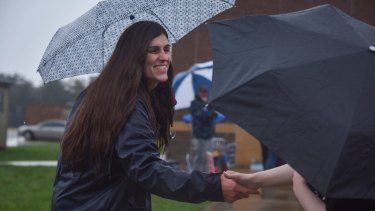 Danica Roem campaigns as voters take to the ballot boxes at Gainesville Middle School in Virginia.