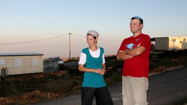 Settlers Michal and Matanya Chayat in the illegal outpost of Kida in the Israeli-occupied West Bank.