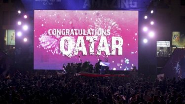 Qataris celebrate in Doha after being awarded the 2022 World Cup in 2010.