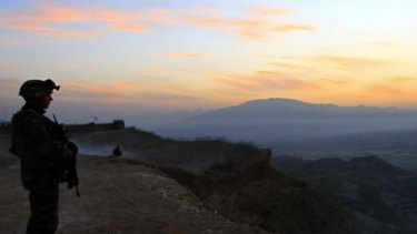 By dawn's early light, a French soldier on duty in the Surobi province of Afghanistan. France's President Nicolas Sarkozy now says he will consider an early withdrawal from the country.