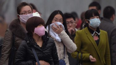 """Run for cover: Chinese commuters in February, when smog reached """"crisis"""" levels."""