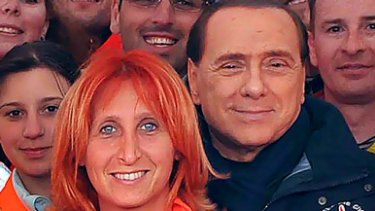 """""""I wouldn't mind being resuscitated by you."""" ... Italian Prime Minister Silvio Berlusconi poses with Dr Fabiola Carrieri."""
