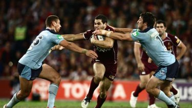 Greg Inglis attacks the Blues defensive line during game two of the State of Origin Series.