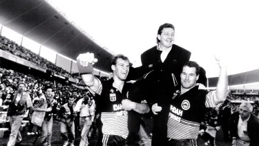 Premiership success: Phil Gould is jubilant after guiding the Panthers to the title in 1991.