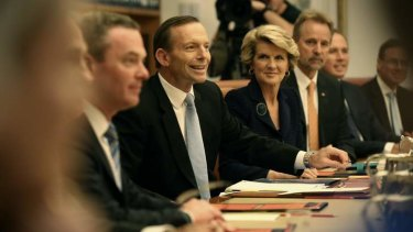 Prime Minister Tony Abbott holds a meeting of the full ministry in the cabinet room at Parliament House on Wednesday.