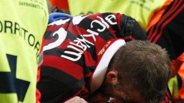 World Cup blow . . . David Beckham reacts after being injured at the San Siro stadium in Milan.