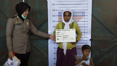 Rehena Begum, a rescued Rohingya mother from Myanmar, is photographed during an Indonesian police identification process at the confinement area in the fishing port of Kuala Langsa, in Aceh, on Monday.