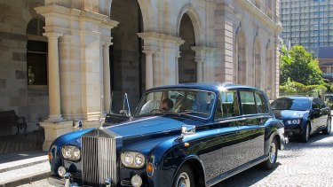 The Rolls Royce is prepared for Governor Penelope Wensley's arrival at Parliament House.