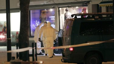 Police investigate the area where three women were killed in a shooting incident outside a restaurant in Imatra, Finland.