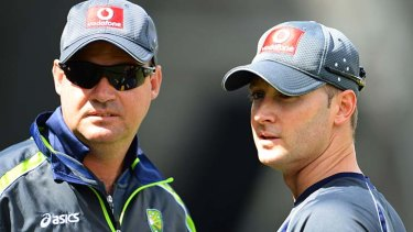 """Meat in the sandwich"": Mickey Arthur (left) claims he was drawn into the feud between Michael Clarke (right) and Shane Watson."