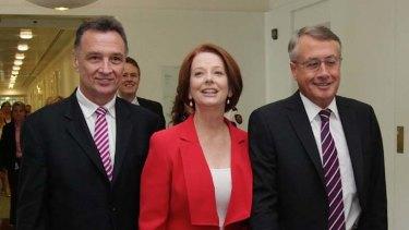 Prime Minister Julia Gillard with Trade Minister Craig Emerson (left) and Treasurer Wayne Swan (right).