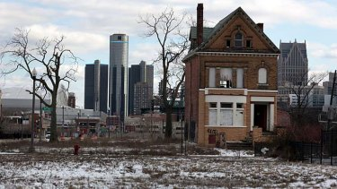 Desolation: A boarded up house of the once thriving Brush Park neighborhood stands in stark contrast to the downtown Detroit skyline.