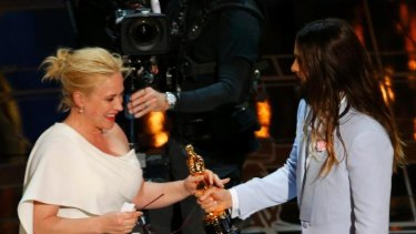 Patricia Arquette accepts the Oscar for Best Supporting Actress for her role as a single mum in Boyhood at the 87th Academy Awards in Hollywood.