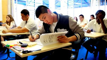 Aengus Tran sits the HSC English exam at Blackwattle Bay in Glebe yesterday.