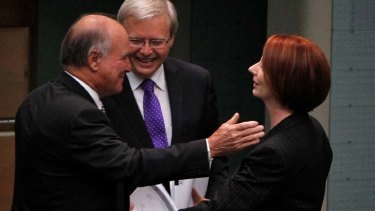 Light relief ... Julia Gillard embraces Independent MP Tony Windsor as Kevin Rudd looks on.