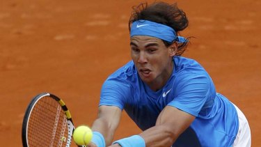 Rafael Nadal stretches to effect a return to Ivan Ljubicic.