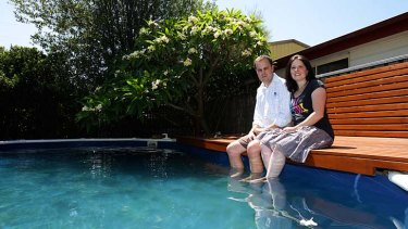 Chain reaction: Clinton Maynard, with wife Cas, was rushed to hospital after the pool chemicals he was mixing exploded.