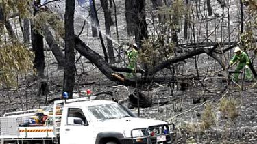 Firefighers mop up at Boolarra, where a bushfire has destroyed at least 29 homes.