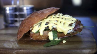 Florentine Panini with fried egg, bacon, hollandaise and spinach.