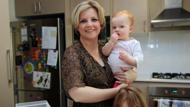 Priorities straight ... it is possible to be a working mum like Samantha Baker, with baby Georgina and Ella, 4.