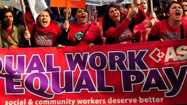 Women demonstrate for equal pay last year.