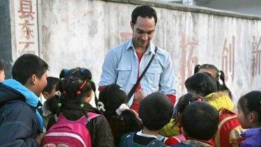 On the scene: Garnaut with children at Sigu Chong Primary School, Huoshan County, Anhui.