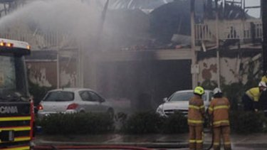 Firefighters at the scene earlier Saturday.