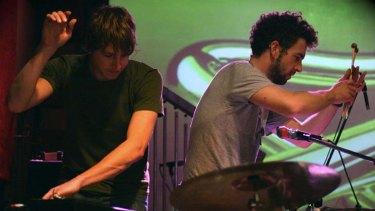 Daniel Holdsworth and Aidan Roberts at work on <i>Tubular Bells</i>.
