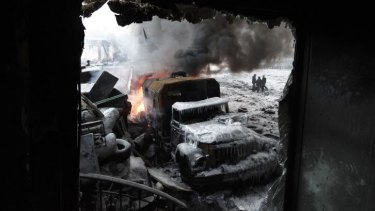 A burnt truck is seen at the site of clashes protesters and riot police in Kiev.