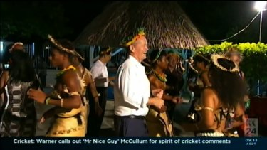 Bill Shorten dances with locals during a trip to Kiribati to raise awareness of climate change.