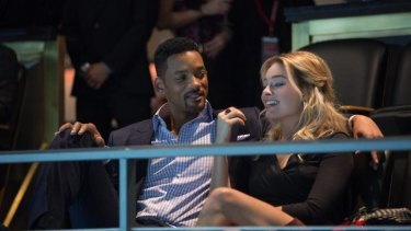 Margot Robbie and Will Smith in <i>Focus</i>.