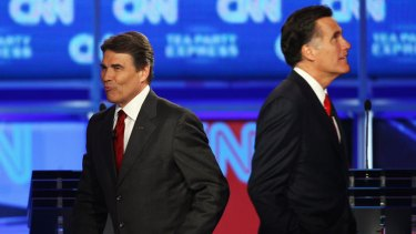 Pot shots … Rick Perry, left and Mitt Romney at the latest debate.
