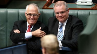 Communications Minister Malcolm Turnbull and Immigration Minister Scott Morrison during question time. Photo: Alex Ellinghausen