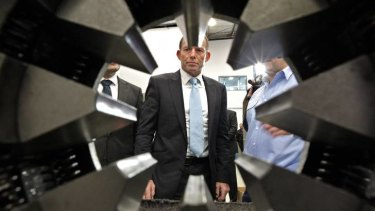 Persisting with his campaign ... the Opposition Leader, Tony Abbott, visits a factory in Rydalmere yesterday.