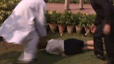 Tripping up ... Ms Gillard tumbles near the Gandhi memorial in Delhi.
