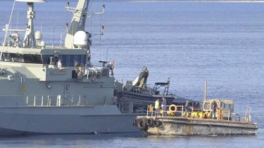 The navy intercepts a boat full of asylum seekers: Australia has been found guilty of violating the human rights of 46 refugees.