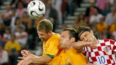 Scott Chipperfield (L) and Mark Viduka of the Socceroos jump for the ball with Niko Kovac of Croatia during the 2006 World Cup clash.