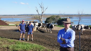 Retired army Brigadier Darren Naumann with farmers David and Tony Vollmer during last month's floods in the Hunter Valley.