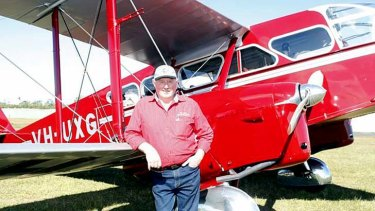Des Porter with the restored bi-plane which was used in the 1930s by the Royal Flying Doctor Service.  <B><A href= http://www.caboolturenews.com.au/story/2012/10/01/police-search-missing-plane/ > Photo: Nicola Brander, Caboolture News  </a></b>