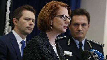 Prime Minister Julia Gillard announces the new anti-gang taskforce at a press conference with AFP Commissioner Tony Negus and Home Affairs minister Jason Clare.
