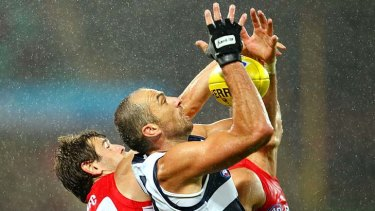 Geelong's James Podsiadly takes a mark under pressure.