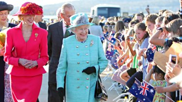 Royal chic ... Quentin Bryce welcomes the Queen to Australia - in regal style.